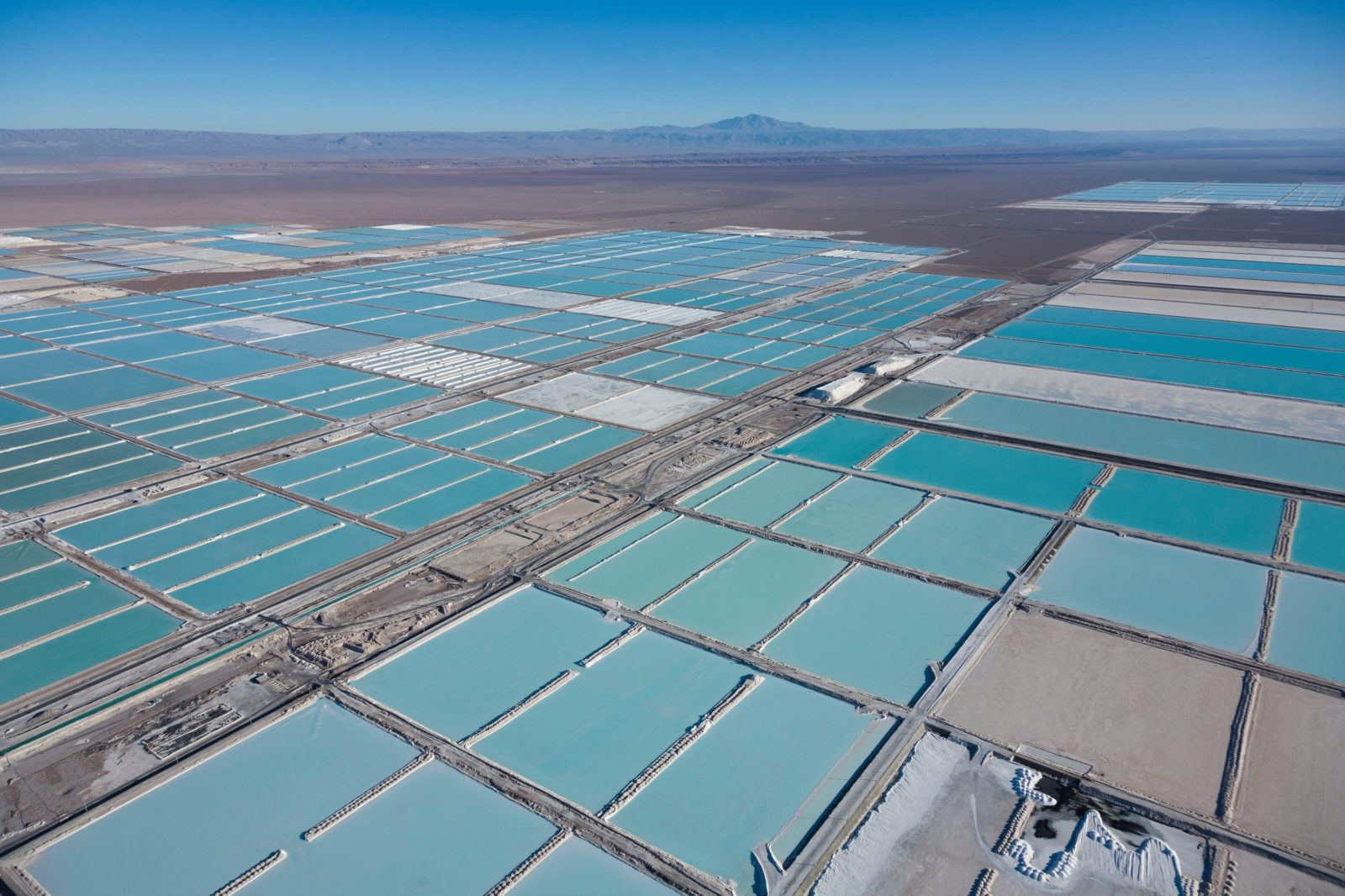 Chile, Antofagasta region, San Pedro de Atacama, Atacama salar, the world's largest lithium deposit, evaporation ponds of the Sociedad Quimica Mineral de Chile lithium mine or SQM and Sociedad Chilena del Litio or SCL (aerial view)