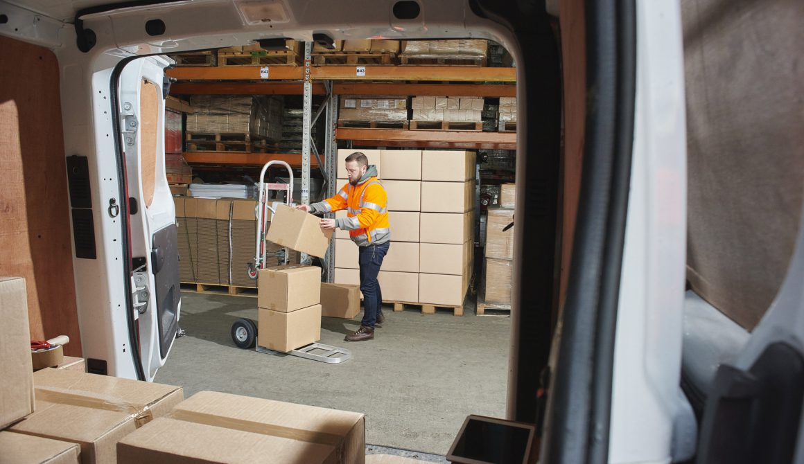 courier filling his van