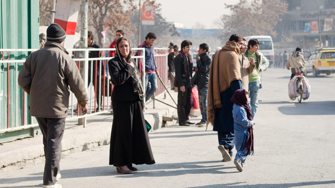Afghan lady waiting to cross the street in Kabul