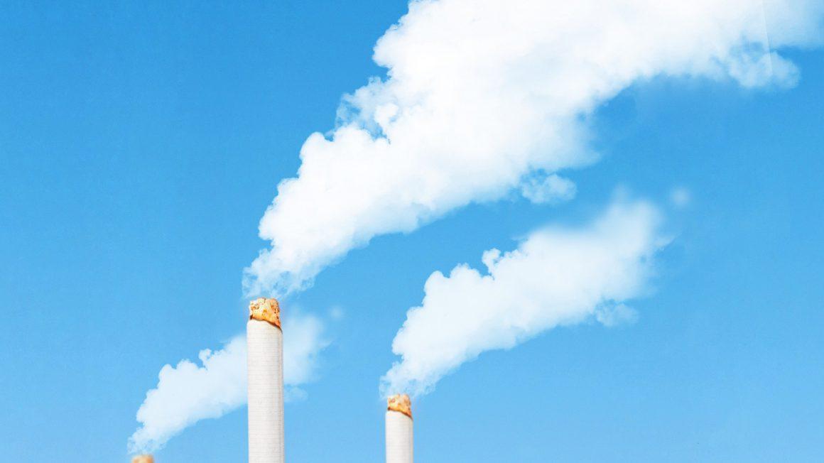 ์No Smoking Concept : Abstract image of White smoke floating and emission from chimney that made from many cigarettes with blue sky in background.